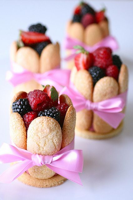 Berry Charlottes - homemade lady fingers, filled with mousse, topped with fresh berries and tied with a bow