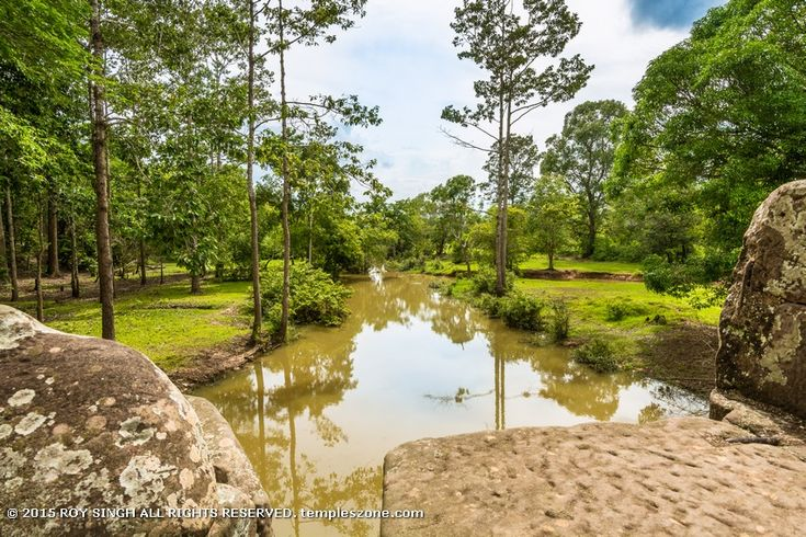 Angkor Thom city (two miles north of Angkor Wat) is surrounded by the moat and it's about four square miles, laid out in a square and for centuries it was the seat of the Khmer government.