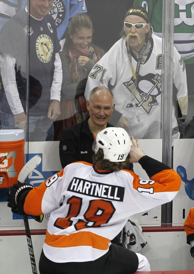 Philadelphia Flyers Scott Hartnell mocks a Pittsburgh Penguins fan near the end of their NHL hockey game against the Penguins in Pittsburgh, Pennsylvania, April 1, 2012. REUTERS/Jason Cohn (UNITED STATES - Tags: SPORT ICE HOCKEY)