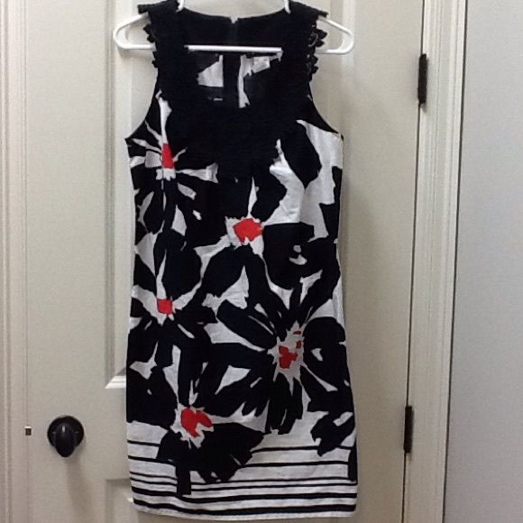 Black, White & Red Floral Dress Cute black white and red floral dress. Has lace trim around neckline. Zipper going down the back. Dress measures 37 inches. Size: 9/10. Shell: 100% cotton. Lining: 97% cotton, 3% spandex. Great condition! B. Smart Dresses Mini