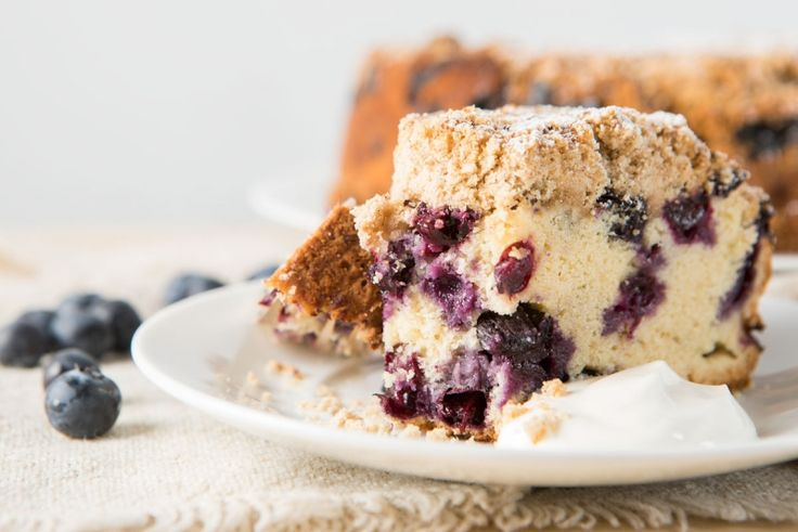 slice of blueberry buckle cake on a plate