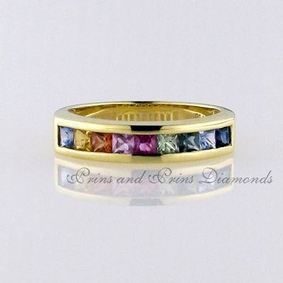 There are 9 = 0.41ct princess cut multi-colour sapphires channel set in 18k yellow gold