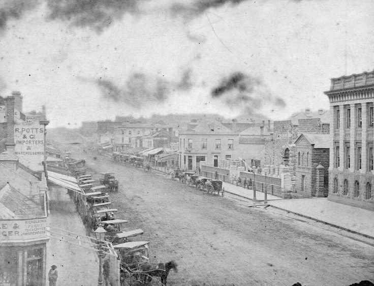 Swanston St,Melbourne,in Victoria in 1858.From the corner of Collins St looking north. Businesses included *R.Potts & Co Importers and Warehousemen *Nicholson's Family Tea & Coffee Warehouse.