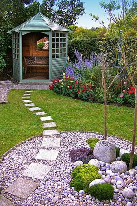 #4. Lay square stepping stones over a grass and river rocks garden path. Lay a Stepping Stones and Path Combo to Update Your Landscape