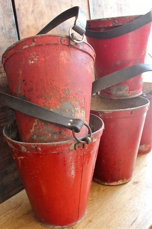 Fabulous old fire buckets...love the leather straps