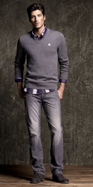 Gray sweater, checked button down, faded jeans and just slightly blue suede shoes