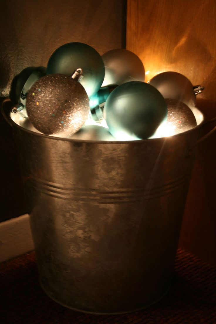 Ornaments and Lights in a Bucket neat night light idea in powder room for holidays