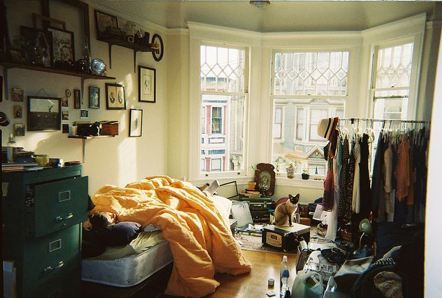 Flat in San Francisco..I like how comfortable this looks and the framed pictures on the wall and the gorgeous lighting!