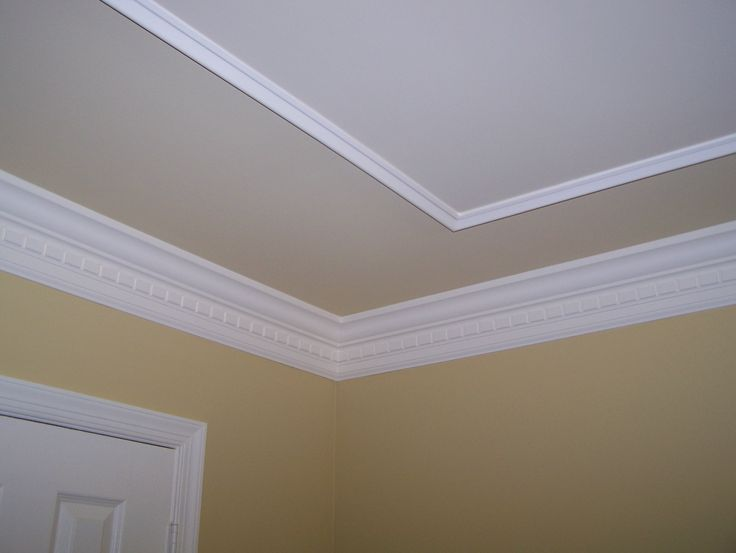 Don't have the height for a tray ceiling but may be able to fake one.