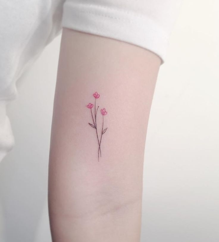 Fine line flower tattoo by playground_tat2.   These tattoos for women will bring out the beauty within, they are the depiction of dreams, they are there to compliment your skin, not take over. Enjoy!