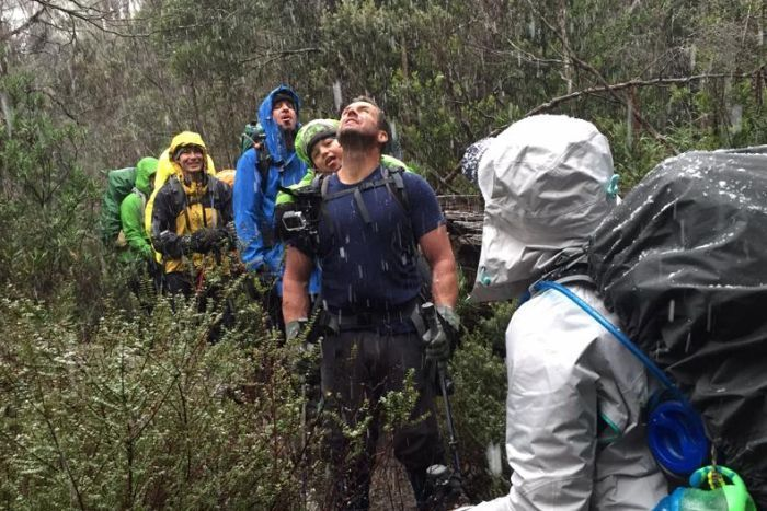 Chris Duffy carries his son during a week-long bushwalk as it starts snowing.