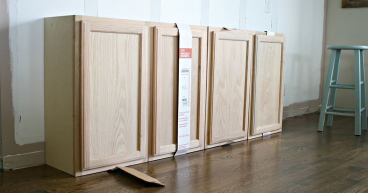 How to use affordable, unfinished kitchen cabinets to create built in storage and bookcases.