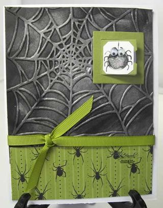 """Embossed spider web Halloween card. With spider """"wallpaper"""" and ribbon."""