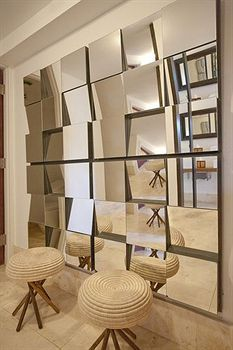 Neat idea for a wall you don't know what to do with, adds light and space!