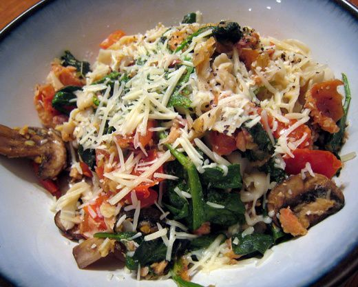 A re-creation of a wonderful pasta dish I ate on Whidbey Island in Wash. State, this is fresh with tomatoes, mushrooms, and spinach.