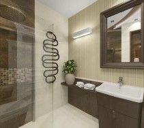Elegancka łazienka z oryginalną fakturą ściany. Wnętrze zaopatrzono w lustro o bardzo grubej, ciemnobrązowej ramie.