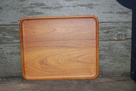 Beautiful Slimline Mid Century Danish Modern Rectangle Teak Molded Wood Platter ~ Scandinavian Teak Serving Tray ~ Bent Wood Serving Tray  Stamped on the back, but we are unable to read it.  size: 13 3/4 long * 11 1/4 * 3/4 thick  condition: light wear without chips, cracks,