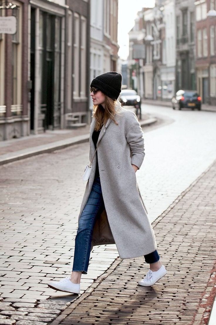 gray duster coat, skinny jeans, sneakers, and a beanie hat