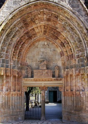 Archway Entrance To The 10th Century Roman Abbey At Moutier D'Ahun, La nef du 15°s a disparue, à l'exception du grand portail de style flamboyant. Carré du transept, choeur et clocher sont romans.