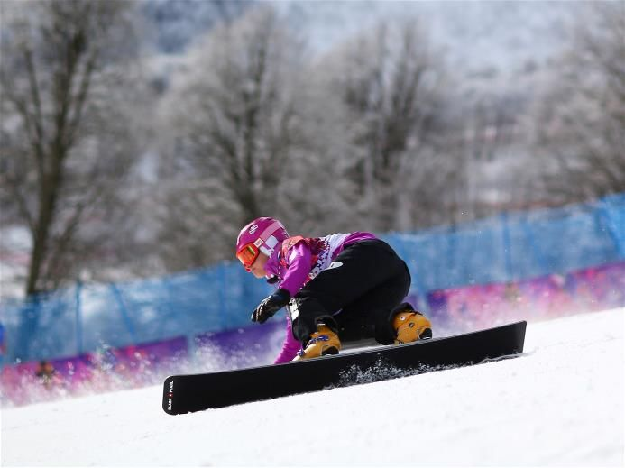 Tomoka Takeuchi of Japan competes in the Snowboard Ladies' Parallel Giant Slalom Qualification. Sochi 2014 Day 13 - Snowboard Ladies' Parallel Giant Slalom. © 2014 XXII Winter Olympic Games.