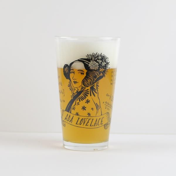 Ada Lovelace Pint Glass (Set of 2) - The VinePair Store - Let your drinking companions know that you know the world's first computer programmer was a woman with this set of pint glasses that pay tribute to Mathematician Ada Lovelace.