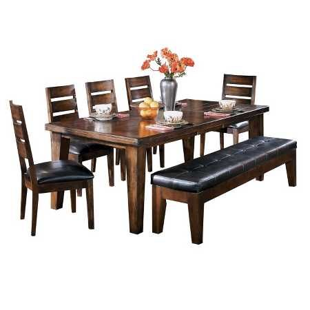 Straightforward design of this dining room table serves a timeless look at every meal. The warm finish exudes pleasingly rustic character. Included extension easily increases the length so more guests can join you at the table. Signature Design by Ashley is a registered trademark of Ashley Furniture Industries, Inc.