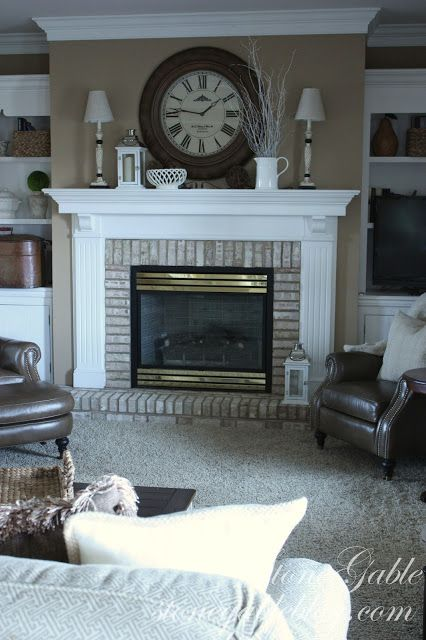 White wash brick fireplace with white mantel surround.  Another possibility for our fireplace.