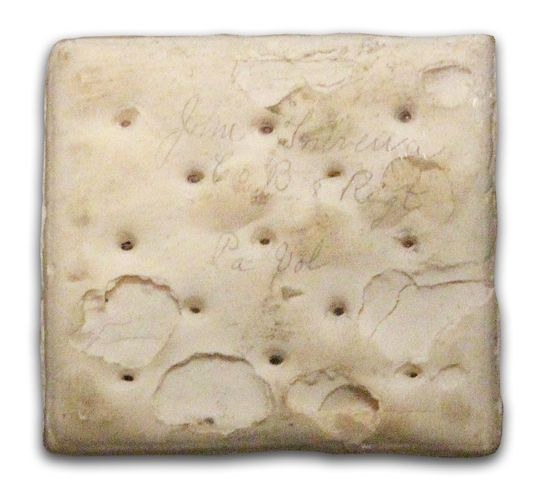 "Civil War Hardtack This cracker was a Union soldier's main ration. Popularly known as ""sheet iron crackers,"" they were notoriously difficult to bite into and chew. Unlike leavened bread, hardtack was quite durable and would keep for a veeeerrrry long time. This cracker was signed by two soldiers of the Eighth Pennsylvania Infantry and kept as a souvenir of their service."