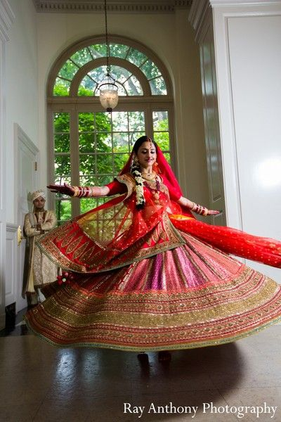An Indian bride and groom pose for wedding portraits.