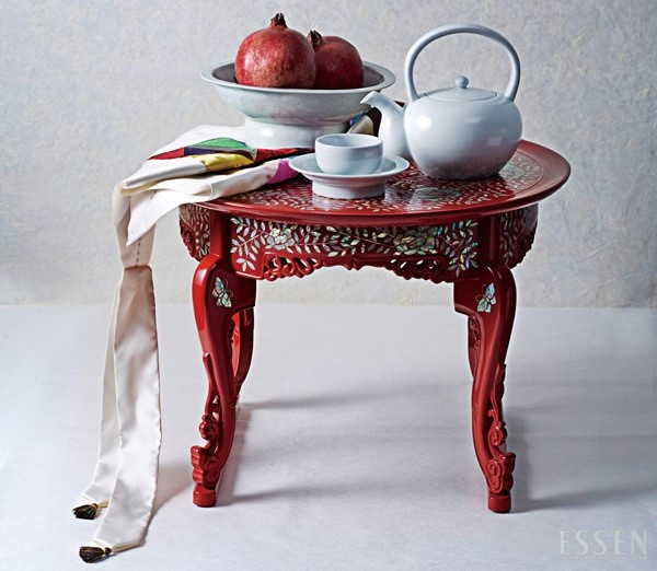 Tea table with Korean traditional white porcelains & patchwork table cover.