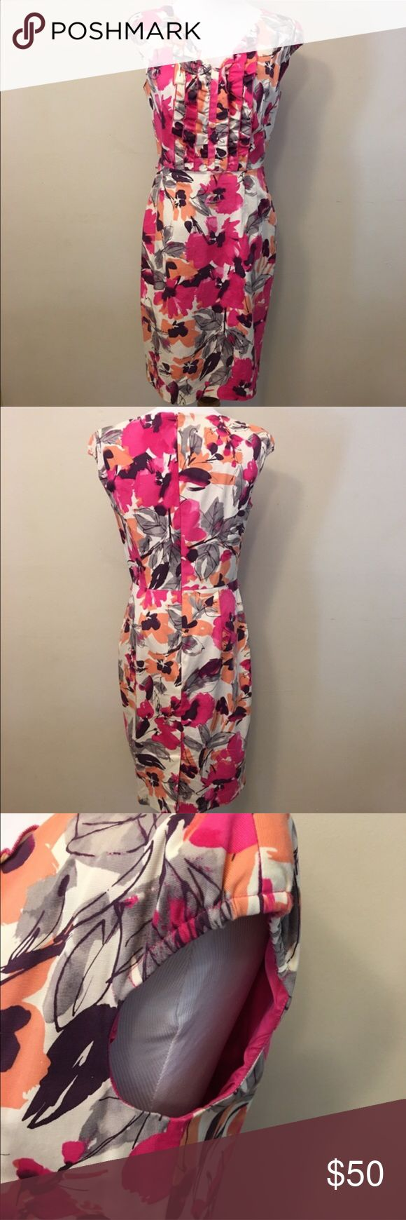 """Adrianna Papell Spring Floral Pencil/Wiggle Dress Beautiful, fully lined dress with small cap sleeves, front ruffles, and a back zip entry. There is a little bit of stretch to this item. About 38"""" at bust, unstretched. 37"""" from shoulder to bottom hem. there was a small white belt with this dress when I originally purchased it, but it is no longer around. (Daughter stole it? Who knows. The universe ate it...) In outstanding condition. Adrianna Papell Dresses Midi"""
