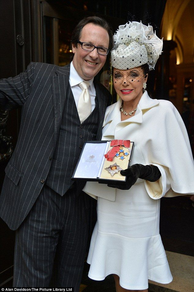 Me and my man: Joan's husband of 13 years Percy Gibson was by her side for her big day