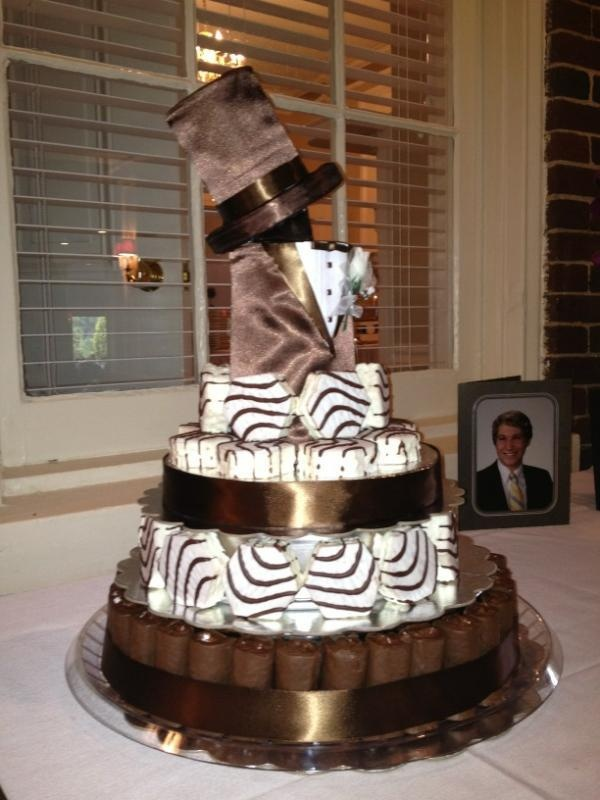 Groom's cake made out of Little Debbie Snack Cakes! WOW!  Ho ho s and zebra cakes on end and back to back