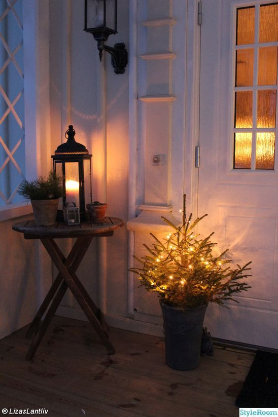 huset,veranda,gran,jul,ljusslinga