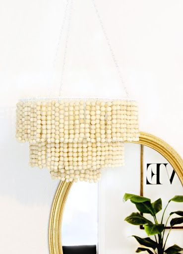 Love this DIY Wood Bead Chandelier - For the patio