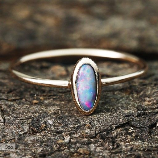 1.4 Carat Black Opal Ring 10K Pink Gold by Anderson Beattie / 500px