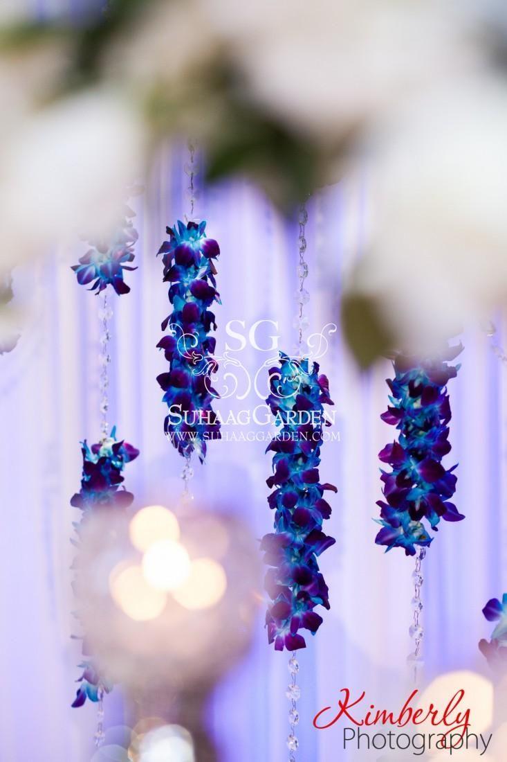 Suhaag Garden, Indian Wedding Decorator, Pakistani Wedding Stage, Crystal Columns, Blue Silver and White, Crystal Globe Candelabras, White Flowers, Dessert Lounge, Valima, Blue Orchid Garlands