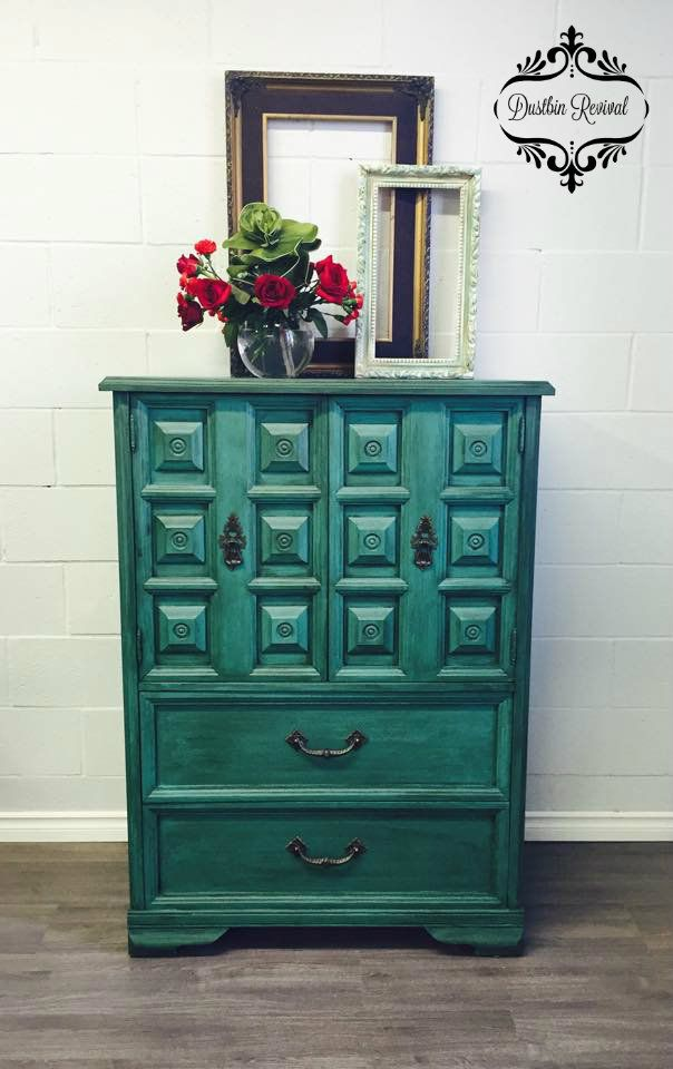 """Stunning vintage bureau beautifully chalked in Annie Sloan """"Florence"""" and treated with antique dark wax to bring out the sheen and depth of all of the intricate wood detail. This is a perfect unit for linens, entertainment center, dresser or a dining room hutch.  2 deep drawers and 2 cedar shelves inside the large doors. Original Hardware."""