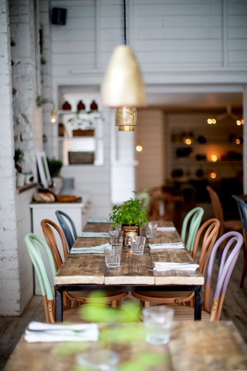 Love how these chairs match but are accented with different pastels.