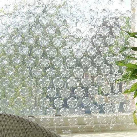 bottoms of plastic bottles used to decorate a wall, looks pretty and also it's green!