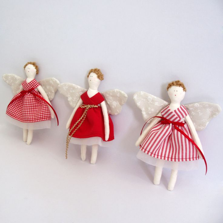 Fabric, delicate fairies in red, well-dressed in 3 red shades and the wings are with soft beige floral fabric.