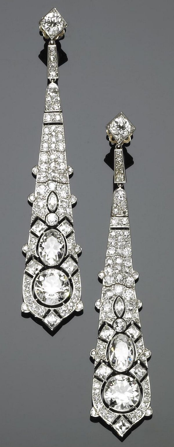 PLATINUM, GOLD AND DIAMOND PENDENT EARRINGS, CARTIER 1925. Each earring set with an old-cut diamond surmounted by an oval diamond within an openwork mount set with diamonds, mounted in platinum and gold, with French assay marks, signed Cartier and numbered. #Cartier #ArtDeco #earrings