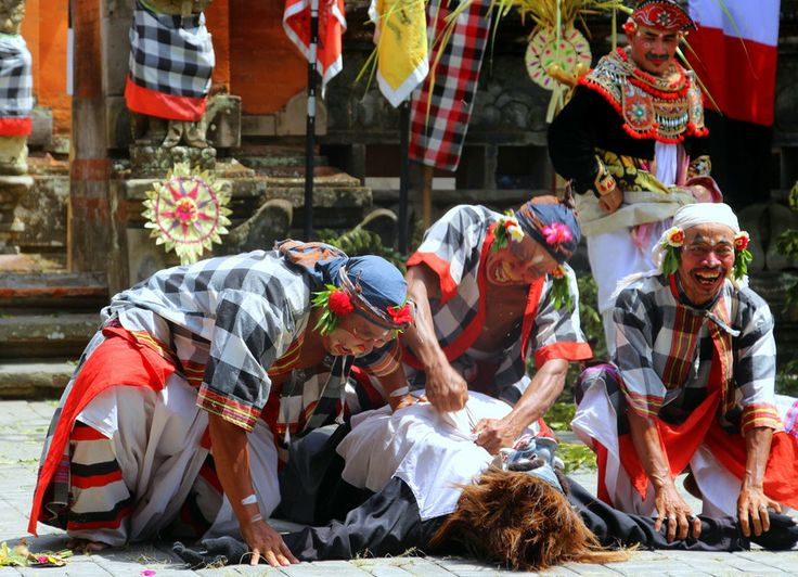 Barong and Kris dance: three men kill a boar in the forest