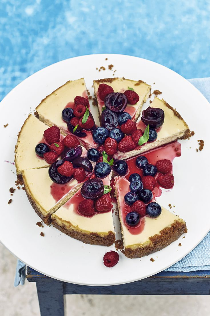 Creamy coconut cheesecake layered with a rich biscuit base and a mixed summer fruit topping. Find this recipe and more on the Waitrose website.
