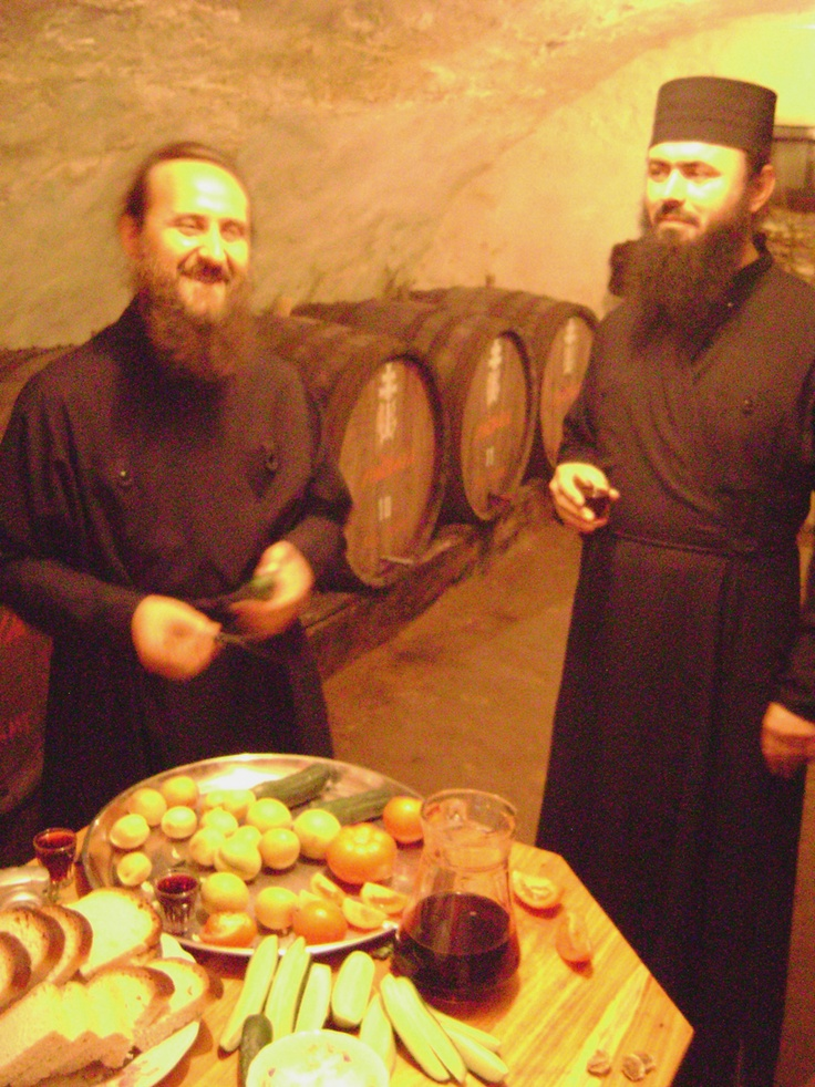 ...very friendly Monks sharing fresh food from their garden and a drop of their wine in Trans Nistria, Moldova.
