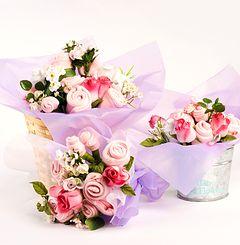 Bouquets hechos con ajuares de bebé