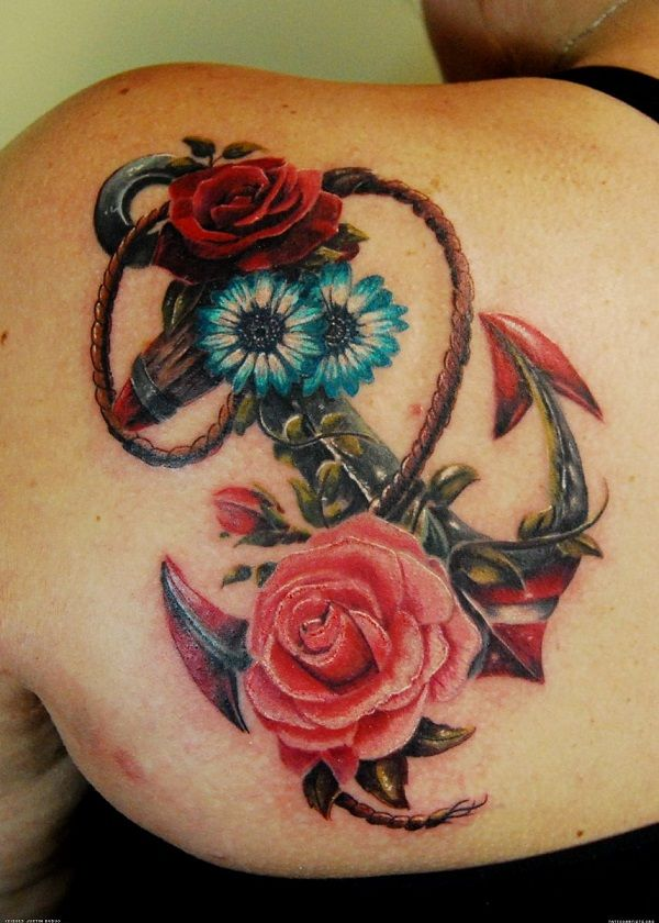 Anchor and flowers tattoo. Beautifully inked and well drawn. The combination of the soft colors and design makes the tattoo look endearing and meaningful.