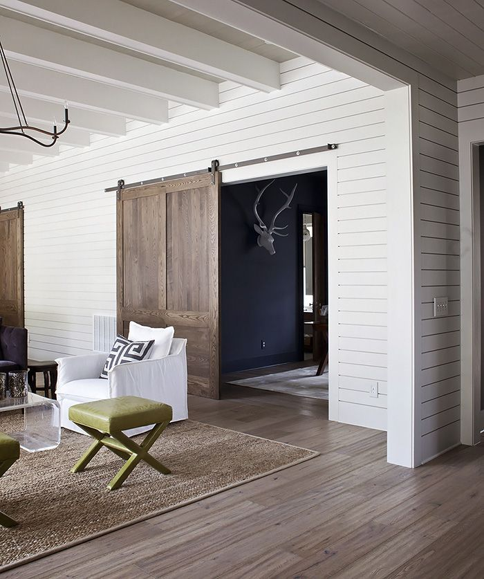 love the barn door, love the mix of styles here, farmhouse, meets contemporary, meets ranch house? Nice color floors also
