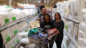 May 2016 | A group of Syrian refugees in Calgary is rallying together donations to help residents of Fort McMurray. A community of people only in Canada for a few months and with very little to their names is responding with immediacy to the needs of the country who took them in. Saima Jamal (centre), the co-founder of the Calgary-based Syrian Refugee Support Group, is seen buying donations with Syrian refugee Rita Khanchat, her husband Salen (left) and son Eli (top left). (Syrian Refugees…
