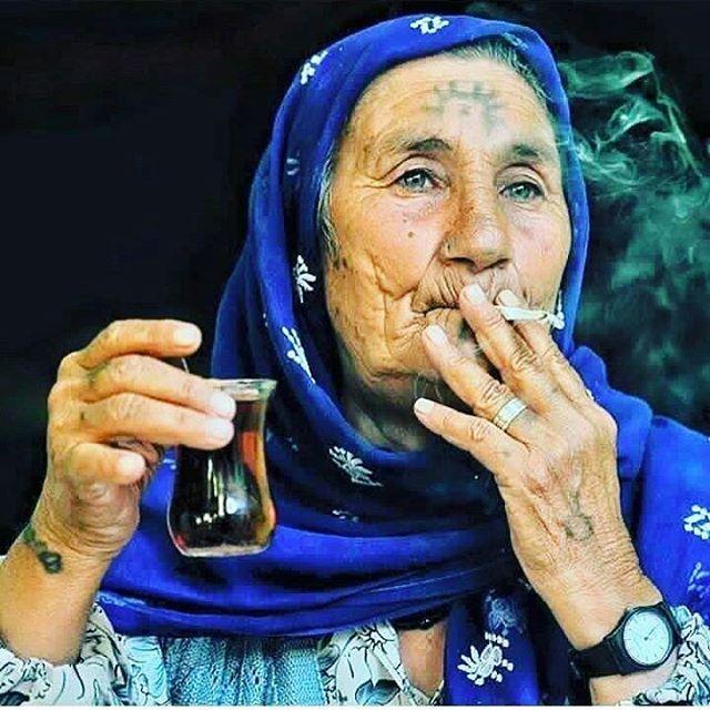 Elderly Kurdish Woman with traditional Tattoos. Note the Sun Symbol - many Kurds, especially the Yazidi Kurds, still wear Tattoos associated with Iranian Sun God Mithras.
